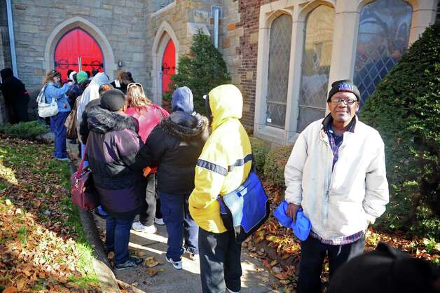 Lionel Creve, of Bridgeport, stands in line Wednesday, Nov. 14, 2012 outside Golden Hill Church in Bridgeport for the Bridgeport Rescue Mission's Thanksgiving Pantry Bag / Turkey and Coat distribution.  Volunteers will be distributing turkeys and all the fixings along with warm winter coats through Nov. 21, 2012. Photo: Autumn Driscoll / Connecticut Post