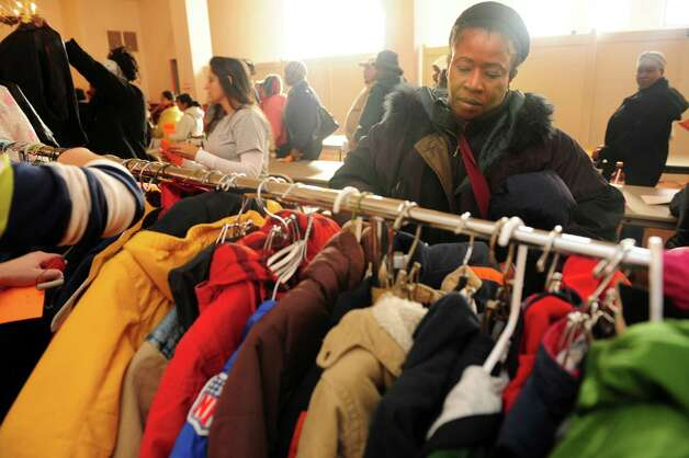Desirne Henry, of Stratford, looks for winter coats for her children Wednesday, Nov. 14, 2012 at Golden Hill Church in Bridgeport during the Bridgeport Rescue Mission's Thanksgiving Pantry Bag / Turkey and Coat distribution.  Volunteers will be distributing turkeys and all the fixings along with warm winter coats through Nov. 21, 2012. Photo: Autumn Driscoll / Connecticut Post