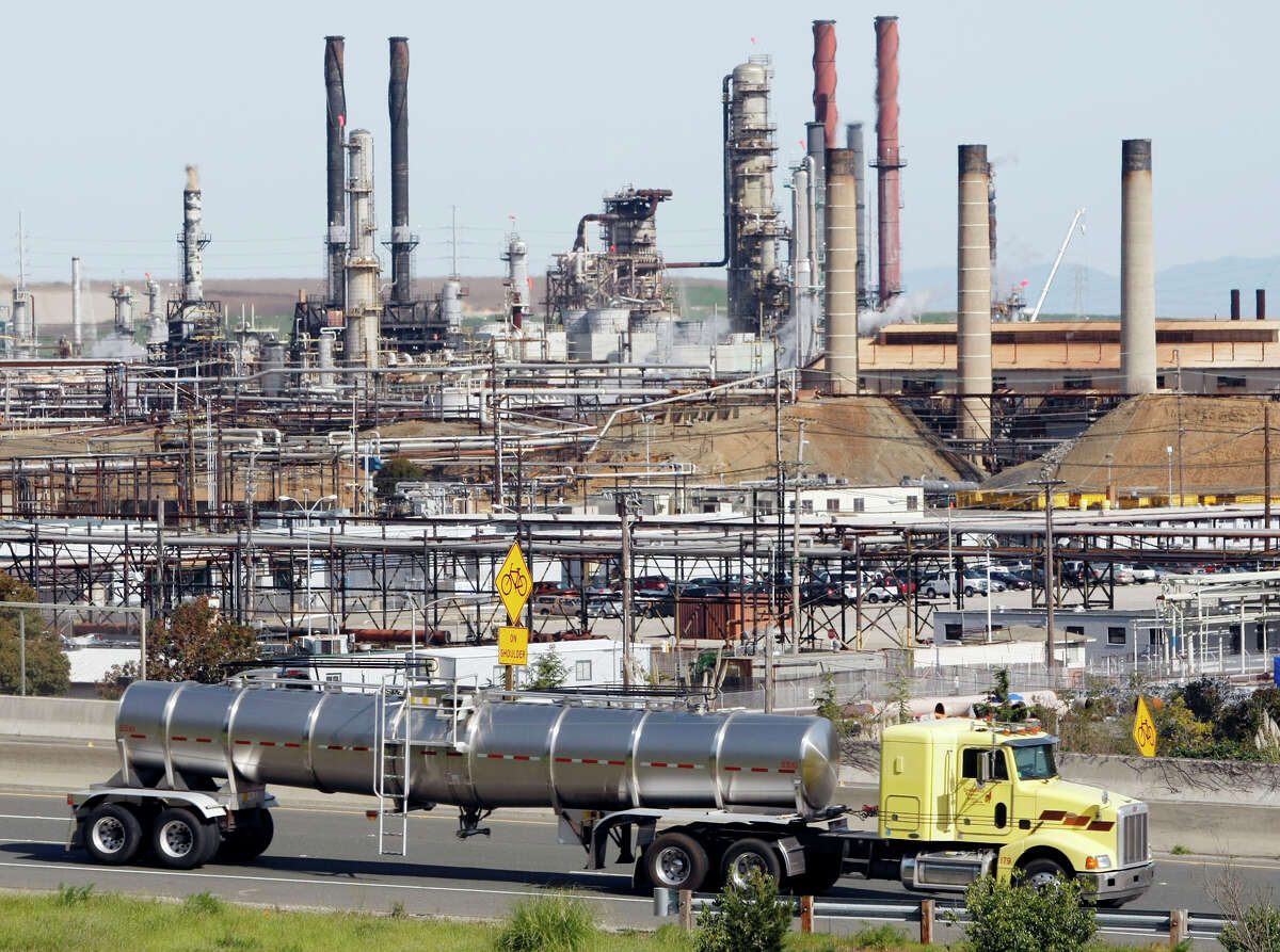 The Chevron oil refinery in Richmond would take a backseat to renewable energy sources as the new slew of state bills to combat climate change would slash oil use in California in half by 2050 to meet Gov. Jerry Brown's ambitious goals.