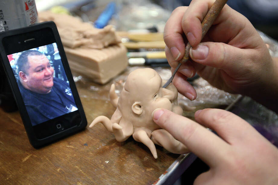 Celestia Ward of Las Vegas creates a caricature sculpture during the artists convention at El  Tropicano Hotel. Photo: Jerry Lara, San Antonio Express-News / © 2012 San Antonio Express-News