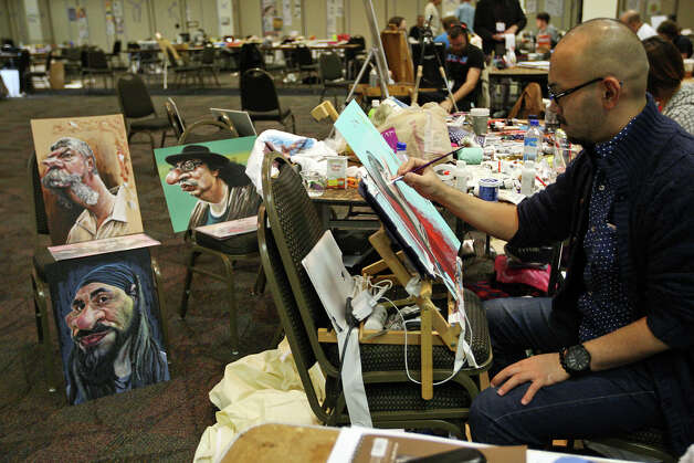 Taka Watanabe, of Tokyo, Japan, works on a canvas during the International Society of Caricature Artist annual convention at El Tropicano Hotel, Wednesday, November 14, 2012. Photo: Jerry Lara, San Antonio Express-News / © 2012 San Antonio Express-News