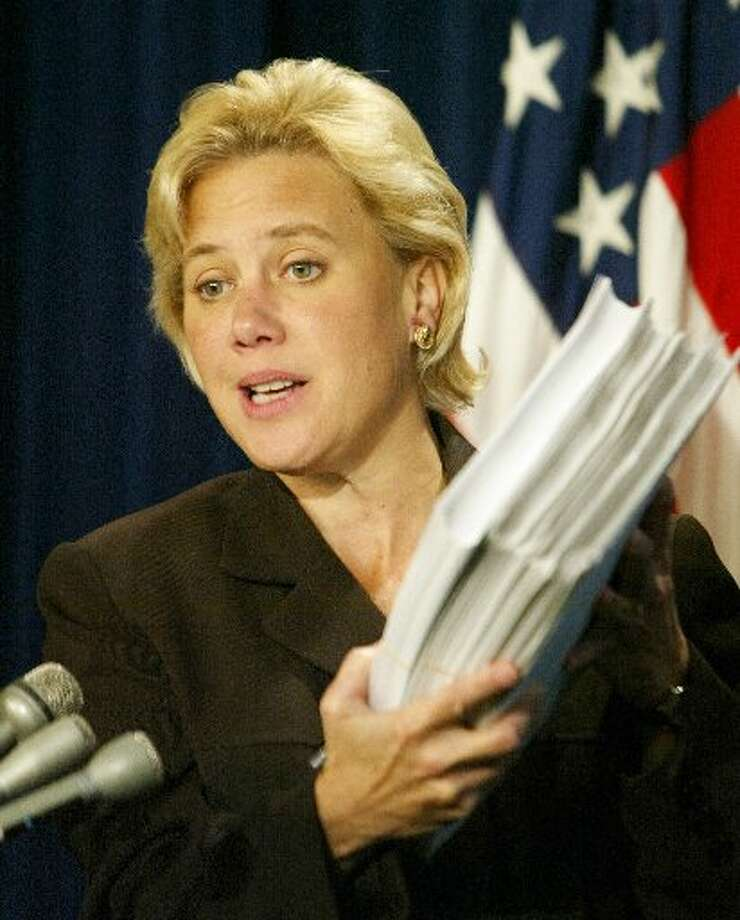 Sen. Mary Landrieu, D-La., holds up the tax bill which was passed by the Senate. (	CHARLES DHARAPAK/AP)