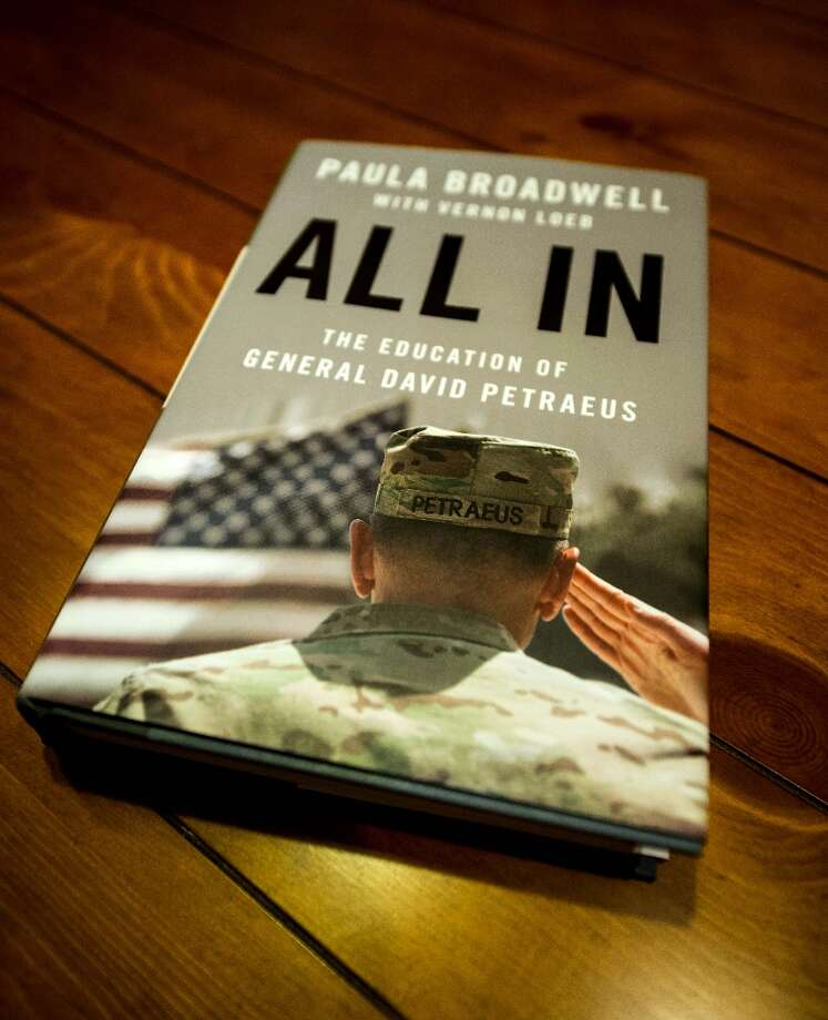 "Biographer Paula Broadwell's book ""All In: The Education of General David Petraeus,"" is seen on a desk in Manassas, Virginia, on November 13, 2012. Petraeus' surprise resignation as CIA director resulting from an extramarital affair has now spiraled into a complicated story of infidelity, intrigue and politics. Photo: KAREN BLEIER, AFP/Getty Images / AFP"