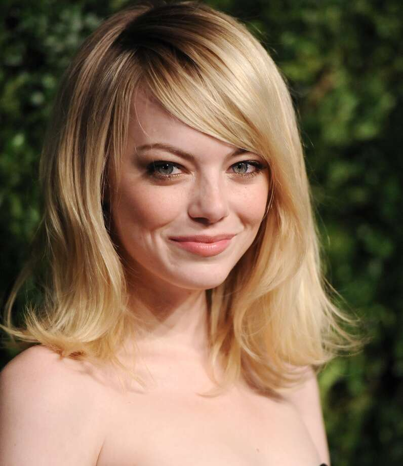 Actress Emma Stone attends the 2012 CFDA / Vogue Fashion Fund Awards on Tuesday Nov. 13, 2012 in New York. (Photo by Evan Agostini/Invision/AP) Photo: Evan Agostini, Associated Press / Invision