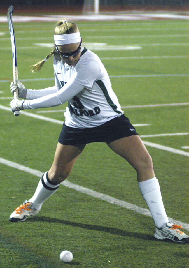 Brianna Reda of the Green Wave winds for an aggressive hit during New Milford High School field hockey's 2-2 deadlock with Lauralton Hall in the South-West Conference championship match, Nov. 6, 2012 at Pomperaug High in Southbury. Photo: Norm Cummings
