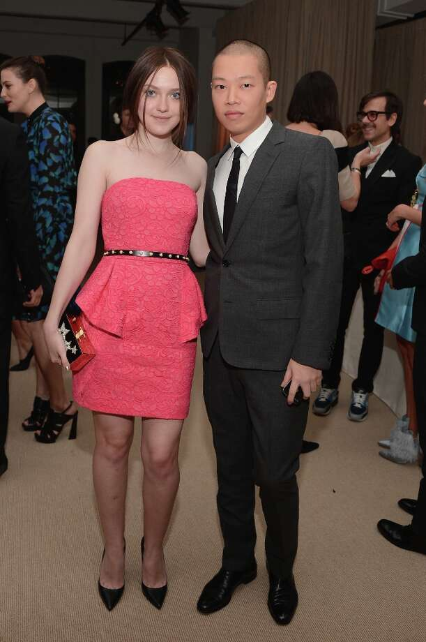 Actress Dakota Fanning and designer Jason Wu attend The Ninth Annual CFDA/Vogue Fashion Fund Awards at 548 West 22nd Street on November 13, 2012 in New York City.  (Photo by Andrew H. Walker/Getty Images) Photo: Andrew H. Walker, Getty Images / 2012 Getty Images