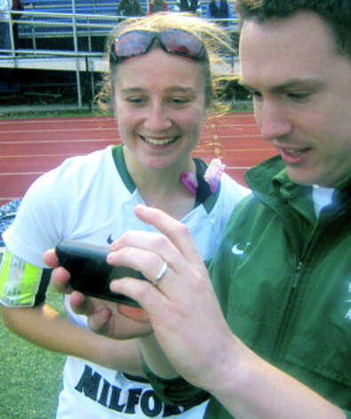 Emily Sanders of the Green Wave thoroughly enjoys seeing the replay, courtesy of NMHS teacher James Tong, of her game-winning goal during New Milford High School field hockey's 1-0 triple-overtime victory over New Canaan in the state  class 'L' quarterfinals at Brookfield High. Nov. 12, 2012 Photo: Norm Cummings