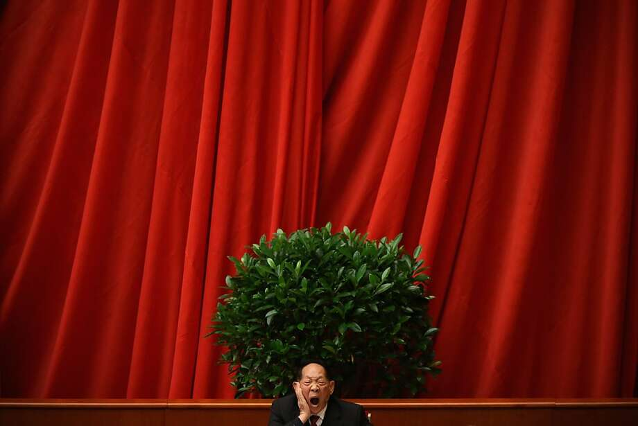 A scientist delegate yawns at stage during the closing session of the 18th National Congress of the Communist Party of China (CPC) inside the Great Hall of the People on November 14, 2012 in Beijing, China. Members of the Standing Committee of the Political Bureau of the new CPC Central Committee will meet with journalists on November 15, 2012. Photo: Feng Li, Getty Images