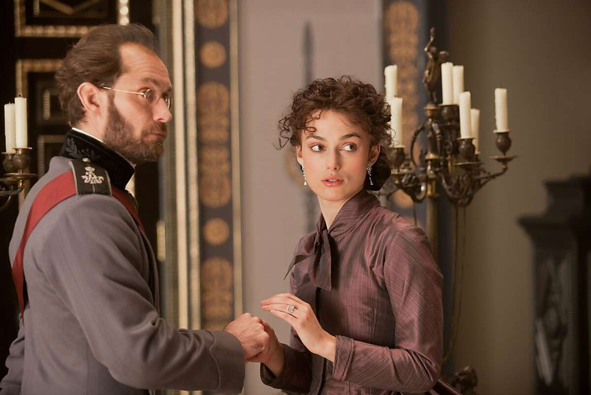 Jude Law is the officious Karenin married to Keira Knightley as Anna in Joe Wright's theatrical yet bloodless
