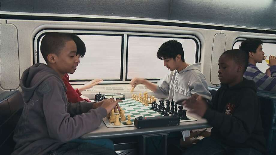 "Members of the I.S. 138 chess team work on their game on the train in ""Brooklyn Castle."" Photo: Producers Distibution Agency"
