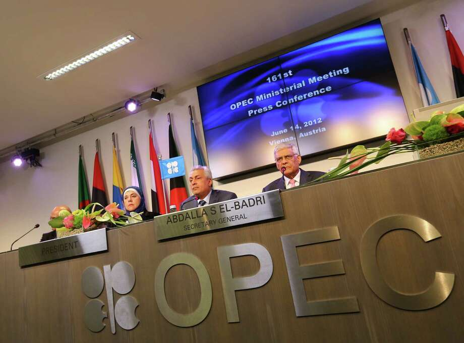 Iraq's Minister of Oil and President of the Organization of the Petroleum Exporting Countries (OPEC) conference, Abdul-Kareem Luaibi Bahedh (2R) and OPEC Secretary General Abdalla Salem El-Badri (R) attend a press conference at the end of the 161st meeting of the OPEC in Vienna, on June 14, 2012. OPEC decided to leave its oil output ceiling unchanged, Algerian Energy and Mines Minister Youcef Yousfi said after the key meeting in Vienna. AFP PHOTO / ALEXANDER KLEINALEXANDER KLEIN/AFP/GettyImages Photo: ALEXANDER KLEIN, Staff / AFP