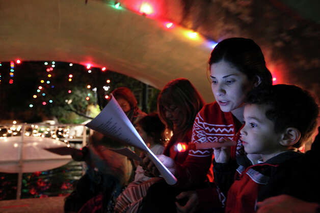 FORD HOLIDAY BOAT CAROLING: School,  church,  company and civic choral groups sing traditional carols on cruising boats. Evenings Nov. 29-Dec. 23 on the River Walk,  210-227-4262. Free for spectators;  $125-$150 for participating groups. Photo: EDWARD A. ORNELAS, SAN ANTONIO EXPRESS-NEWS / eaornelas@express-news.net