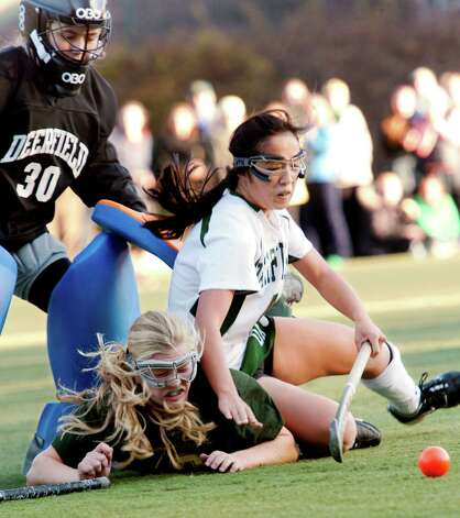 Greenwich Academy's Leigh Gilliland gets knocked down by Deerfield Academy's  Emily Yue in front of the Deerfield goal during a NEPSAC (New England Preparatory School Athletic Council) field hockey quarterfinal game played at Greenwich Academy, Greenwich, CT Wednesday November14th 2012. Photo: Mark Conrad / Stamford Advocate Freelance