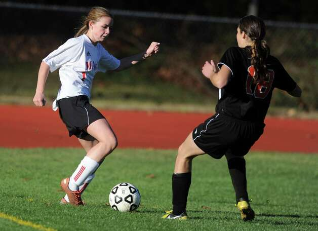 Masuk's Jaime Madden controls the ball as Watertown's Jillian Hughson defends during the Class LL quarterfinals Wednesday, Nov. 14, 2012 at Masuk High School in Monroe, Conn. Photo: Autumn Driscoll / Connecticut Post