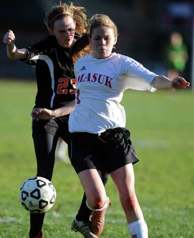 Masuk's Jaime Madden controls the ball as Watertown's Lindsey Sasso defends during the Class LL quarterfinals Wednesday, Nov. 14, 2012 at Masuk High School in Monroe, Conn. Photo: Autumn Driscoll / Connecticut Post