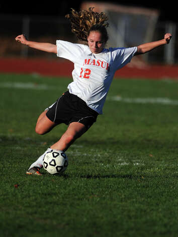 Masuk's Maureen Murphy kicks the ball during the Class LL quarterfinals against Watertown Wednesday, Nov. 14, 2012 at Masuk High School in Monroe, Conn. Photo: Autumn Driscoll / Connecticut Post