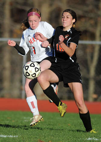 Masuk's Kelsey Brown and Watertown's Jillian Hughson battle for the ball during the Class LL quarterfinals Wednesday, Nov. 14, 2012 at Masuk High School in Monroe, Conn. Photo: Autumn Driscoll / Connecticut Post