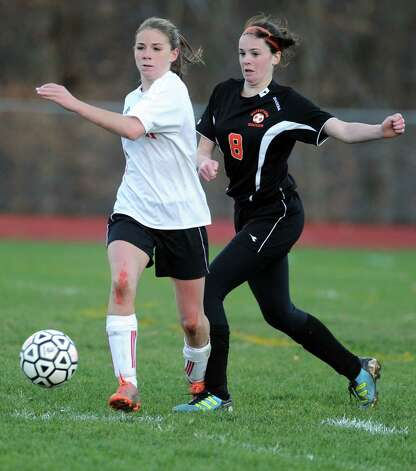 Masuk's Jaime Madden controls the ball as Watertown's Amy Lamontagne defends during the Class LL quarterfinals Wednesday, Nov. 14, 2012 at Masuk High School in Monroe, Conn. Photo: Autumn Driscoll / Connecticut Post