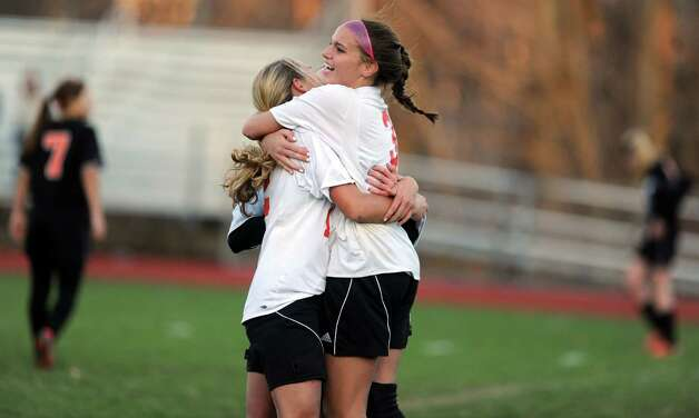Masuk's Emily Montgomery celebrates her game-winning goal during the Class LL quarterfinals against Watertown Wednesday, Nov. 14, 2012 at Masuk High School in Monroe, Conn. Photo: Autumn Driscoll / Connecticut Post