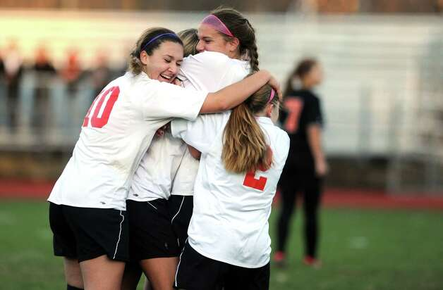 Masuk's Emily Montgomery, top right, celebrates her game-winning goal during the Class LL quarterfinals against Watertown Wednesday, Nov. 14, 2012 at Masuk High School in Monroe, Conn. Photo: Autumn Driscoll / Connecticut Post