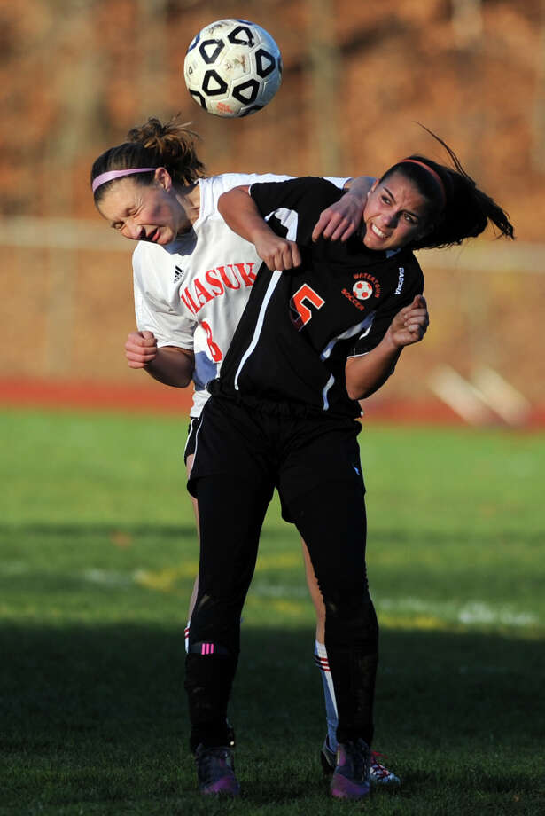 Masuk's Kasey Moraveck collides with Watertown's Olivia Gugliotti as she heads the ball during the Class LL quarterfinals Wednesday, Nov. 14, 2012 at Masuk High School in Monroe, Conn. Photo: Autumn Driscoll / Connecticut Post