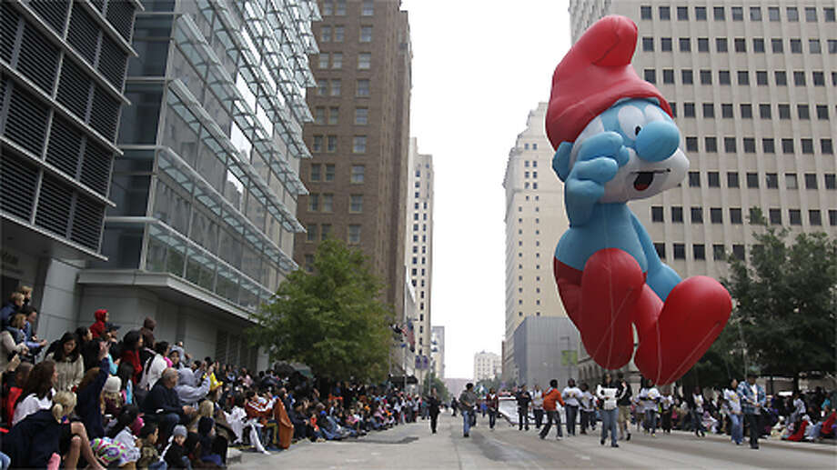 Smurf balloon floats down Fannin St. during  the 62nd Annual Holiday Parade on Thanksgiving Day in downtown Houston Thursday, Nov. 24, 2011. Photo: Melissa Phillip, . / © 2011 Houston Chronicle