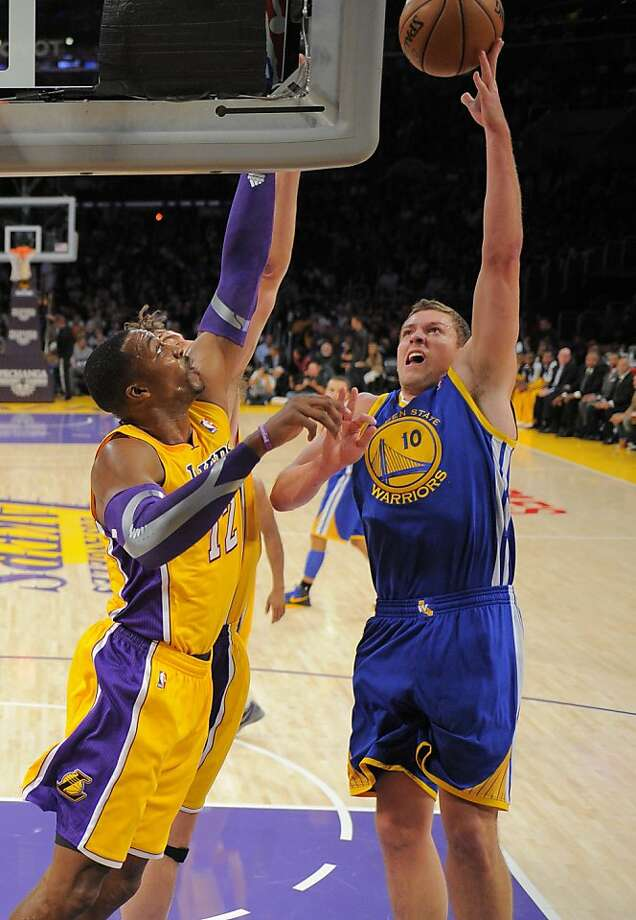 Golden State Warriors forward David Lee, right, puts up a shot as Los Angeles Lakers center Dwight Howard defends during the first half of their NBA basketball game, Friday, Nov. 9, 2012, in Los Angeles. (AP Photo/Mark J. Terrill) Photo: Mark J. Terrill, Associated Press