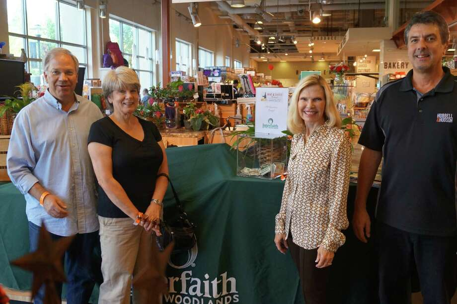 From left, Paul and Sandy Sovelius are pictured with Ann Snyder, president and CEO of Interfaith of The Woodlands, and Fortino Godinez, general manager of Hubbell and Hudson Market.