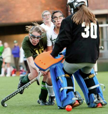 Greenwich Academy's Emilia Tapsall gets another shot past Deerfield Academy goalie  Katherine Heaney to score a goal in a NEPSAC (New England Preparatory School Athletic Council) field hockey quarterfinal game played at Greenwich Academy, Greenwich, CT Wednesday November14th 2012. Photo: Mark Conrad / Stamford Advocate Freelance