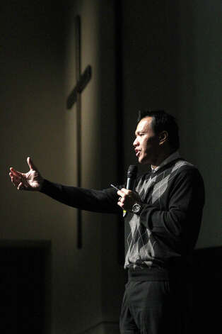 Former Dallas Cowboy and Texas Aggie linebacker Dat Nguyen speaks Tuesday November 13, 2012 at a luncheon held by the Christian Business Chamber of Commerce at Community Bible Church. Nguyen spoke to the group about his faith and his experiences on and off the gridiron. Photo: JOHN DAVENPORT, San Antonio Express-News / ©San Antonio Express-News/Photo Can Be Sold to the Public