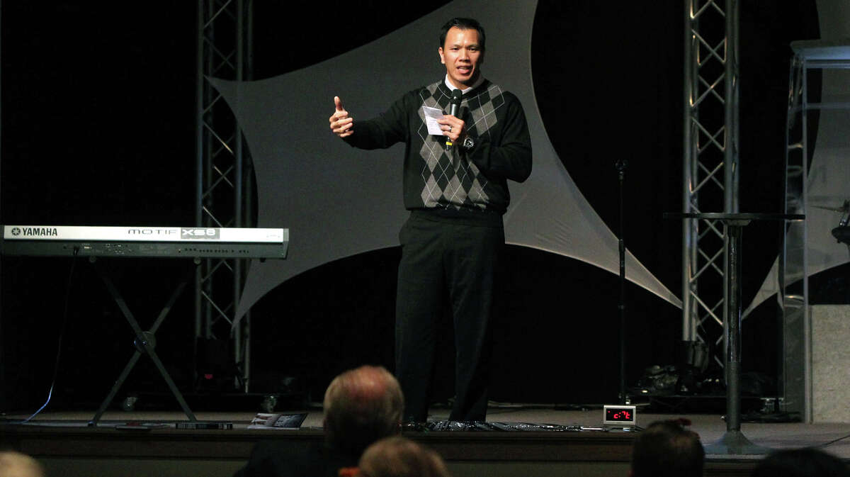 Former Dallas Cowboy and Texas Aggie linebacker Dat Nguyen speaks Tuesday November 13, 2012 at a luncheon held by the Christian Business Chamber of Commerce at Community Bible Church. Nguyen spoke to the group about his faith and his experiences on and off the gridiron.