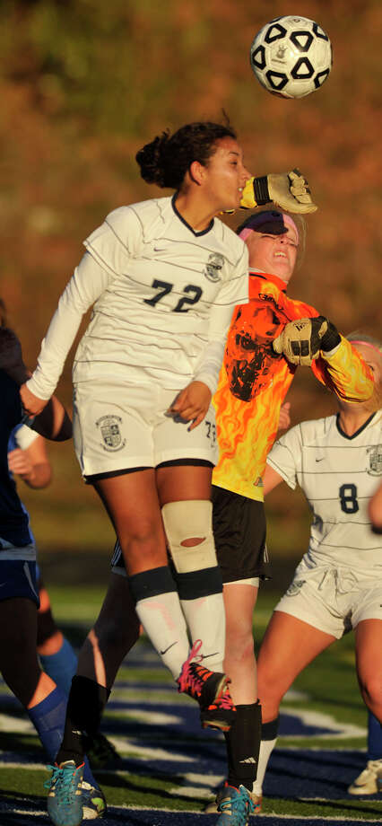 Old Saybrook goalie Mia Neas bats the ball away from Immaculate's Natalia Diaz during their Class S quarterfinal game at Immaculate High School on Wednesday, Nov. 14, 2012. Immaculate won, 1-0 in double overtime. Photo: Jason Rearick / The News-Times