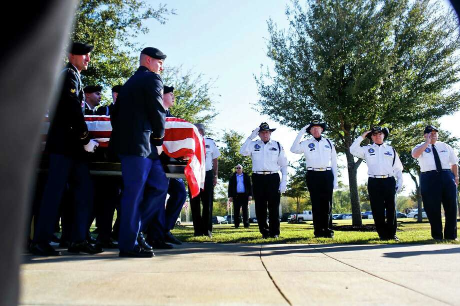 Soldiers carry the casket of Medal of Honor recipient James Stone Sr. at his funeral at Dallas-Fort Worth National Cemetery in Dallas, Texas, on Wednesday, Nov. 14, 2012. Photo: Christian Randolph, Associated Press / The Dallas Morning News