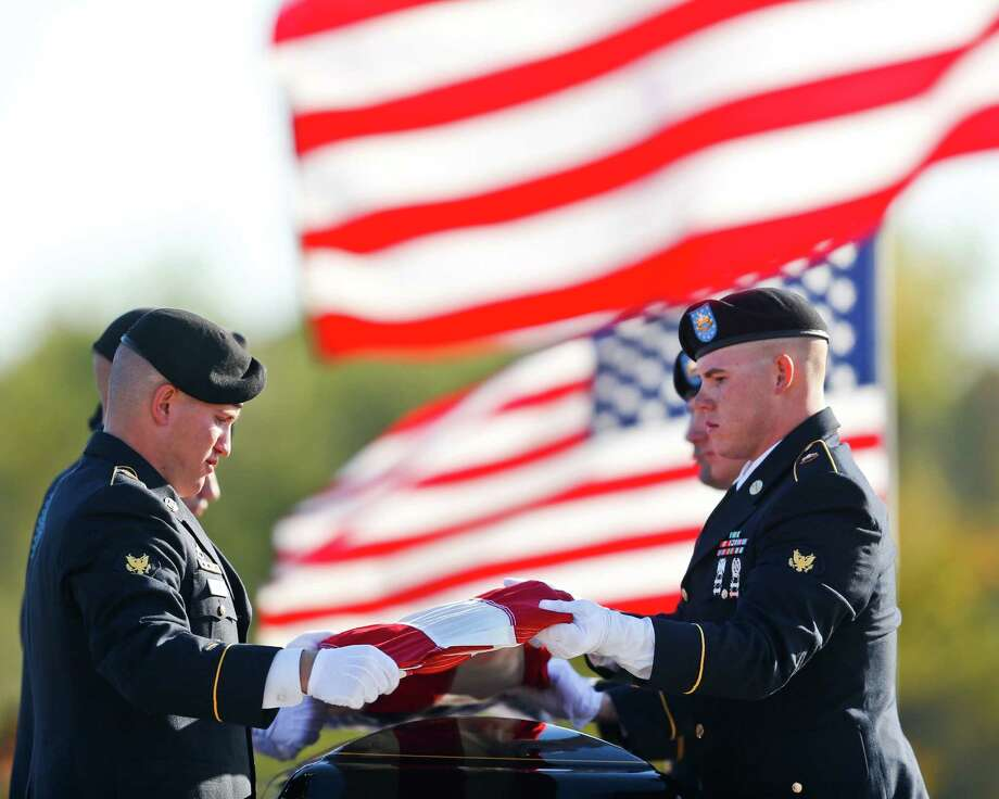 Soldiers prepare an American flag over the casket of Medal of Honor recipient James Stone Sr. at his funeral at Dallas-Fort Worth National Cemetery in Dallas, Texas on Wednesday, Nov. 14, 2012. Photo: Christian Randolph, Associated Press / The Dallas Morning News