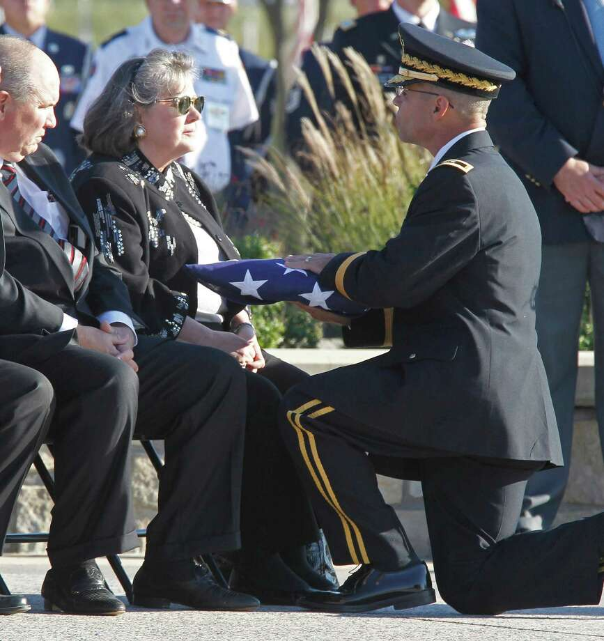 Maj. General Anthony Ierardi of Fort Hood presents a folded U.S. flag to Mary Stone from her husband, Col. James L. Stone's casket during his burial at the DFW National Cemetery in Dallas, Texas, on Wednesday, November 14, 2012. Photo: RON T. ENNIS, McClatchy-Tribune News Service / Fort Worth Star-Telegram