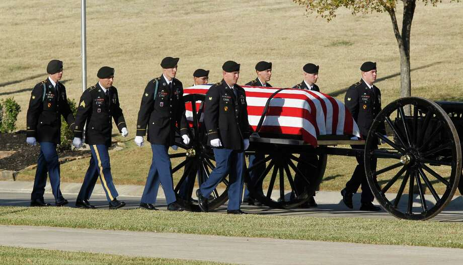 Medal of Honor recipient retired Col. James L. Stone's casket is carried into the burial service at the DFW National Cemetery in Dallas, Texas, on Wednesday, November 14, 2012. Photo: RON T. ENNIS, McClatchy-Tribune News Service / Fort Worth Star-Telegram