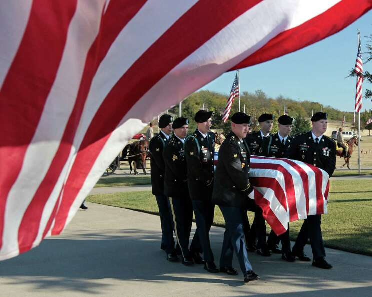 Medal of Honor recipient retired Col. James L. Stone's casket is carried into the burial service at