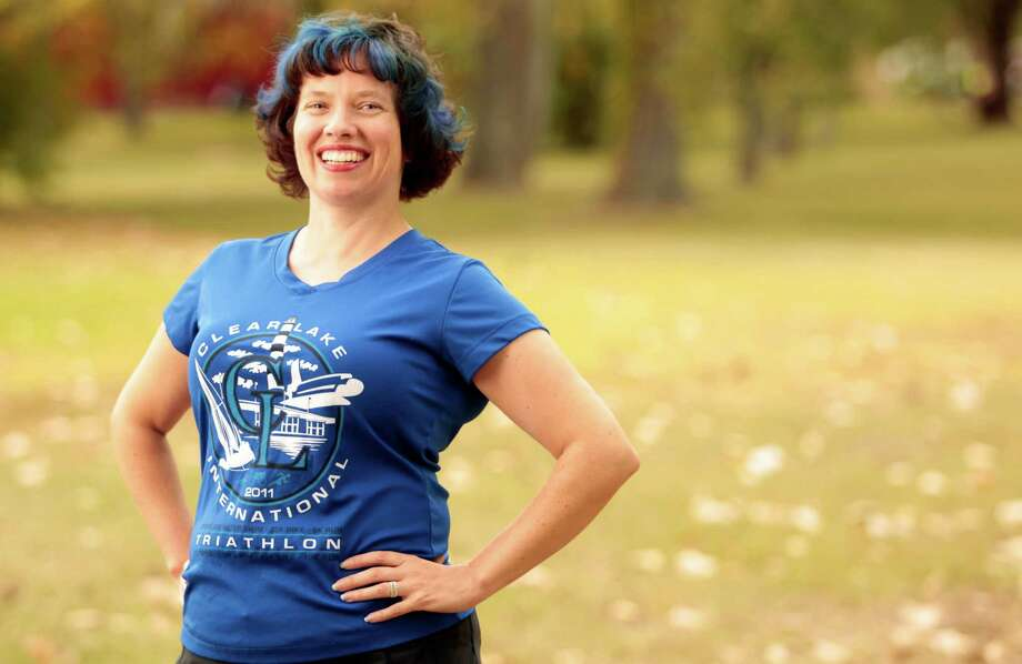 Lisa Danielson will go on a 41-mile run Saturday, one day after her 41st birthday, to raise money for cancer research and celebrate her first year of cancer survival. Photo: Billy Smith II, Staff / Houston Chronicle