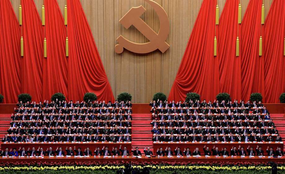 Members of the Presidium convene Wednesday during the closing ceremony of the Communist Party Congress at the Great Hall in Beijing. Photo: MARK RALSTON, Staff / AFP