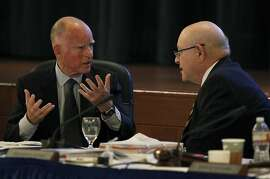 Gov. Jerry Brown confers with UC President Mark Yudof during the governor's appearance at the Board of Regents meeting in San Francisco, Calif. on Wednesday, Nov. 14, 2012.