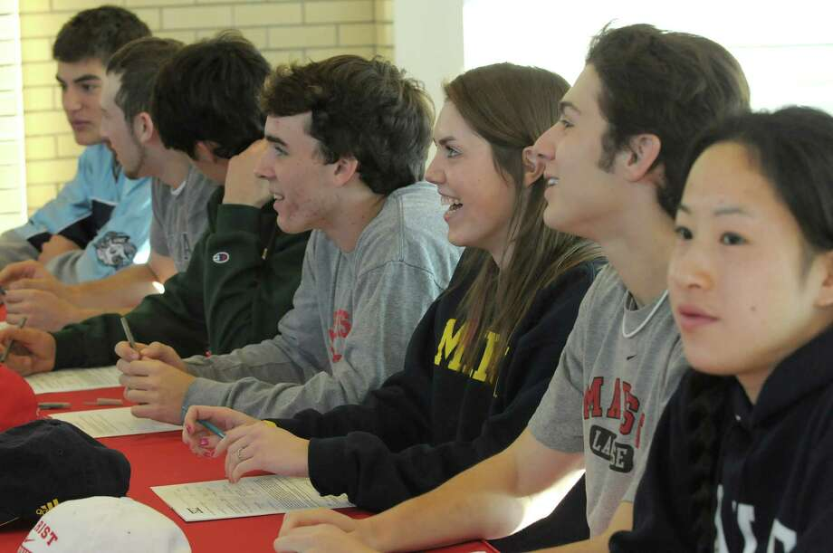 Niskayuna High School seniors, from left to right, Luke Goldstock, Lucas Maloney, Tyler Pantalone, Evan Quinn, Kellly Schlansker, Dom Sloma and Kina Zhou get ready to sign their Division I letters of intent on Wednesday, Nov. 14, 2012 in Niskayuna, NY.  (Paul Buckowski / Times Union) Photo: Paul Buckowski