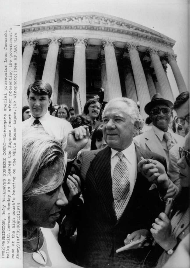 AP CAPTION:  WASHINGTON, JULY 9, 1974 --LEAVES SUPREME COURT-- Watergate special prosecutor Leon Jaworski talks with newsmen Monday as he leaves the Supreme Court after presenting the government's case at the high court's hearing on the White House tapes.  (AP WIREPHOTO) 1974.  HOUCHRON CAPTION (11/05/2000): None (Leon Jaworski in 1974)  HOUCHRON CAPTION (11/05/2000): Leon Jaworski in 1974   HOUSTON CHRONICLE SPECIAL SECTION/TEXAS MAGAZINE: 100 TALL TEXANS.   HOUCHRON CAPTION (12/09/2002):  Jaworski. / AP Wirephoto