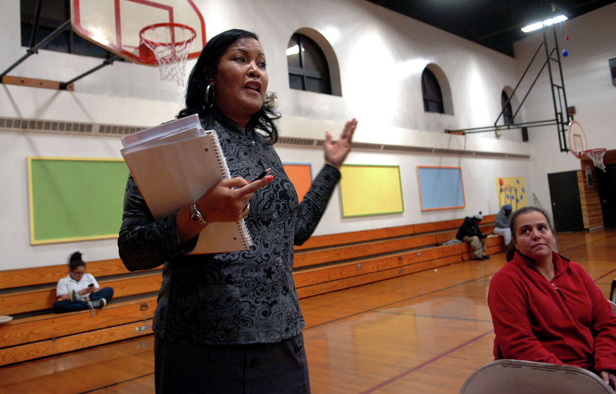 Concerned citizen Thayer Barkley offers her comments, during a panel discussion held by the A.C.L.U. and local activist group EMPOWER (Enlightened Motivated People Organized With Equal Resposibility) which talked about the issue of a cufew in the city as well as other topics and was held at the McGivney Community Center in Bridgeport, Conn. on Wednesday November 14, 2012.