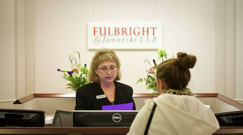 Darleen Taylor, facing, the 51st floor Concierge for Fulbright & Jaworski L.L.P, directs a visitor, Wednesday, Nov. 14, 2012, in Houston. Fulbright & Jaworski L.L.P. has announced that it has entered into an agreement to combine with Norton Rose. ( Nick de la Torre / Houston Chronicle ) Photo: Nick De La Torre, Staff / © 2012  Houston Chronicle