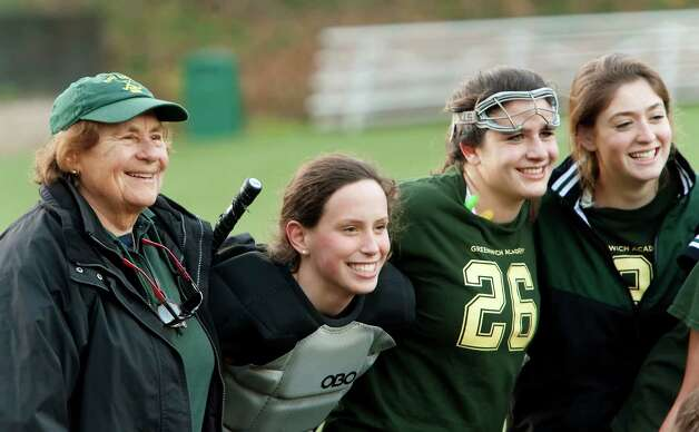 Greenwich Academy field hockey head coach Angela Tammaro with some of her players after defeating Deerfield Academy in a NEPSAC (New England Preparatory School Athletic Council) field hockey quarterfinal game played at Greenwich Academy, Greenwich, CT Wednesday November14th 2012. Photo: Mark Conrad / Stamford Advocate Freelance