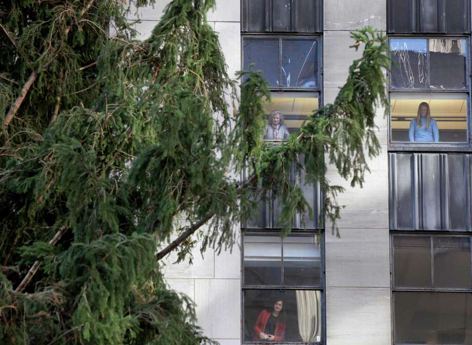 The 80th Rockefeller Center Christmas Tree is suspended by a crane in preparation to be raised at Rockefeller Center,  Wednesday, Nov. 14, 2012, in New York. Photo: Richard Drew, Associated Press / AP