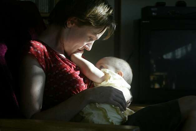 Katrina Friedman breastfeeds her 8 1/2 month old baby daughter, Ruby Alcorn at their home on 9/22/03 in San Francisco.   Friedman has PBDEs in her breastmilk according to a study by The Enviornmental Working Group. Photo: Lea Suzuki, SFC