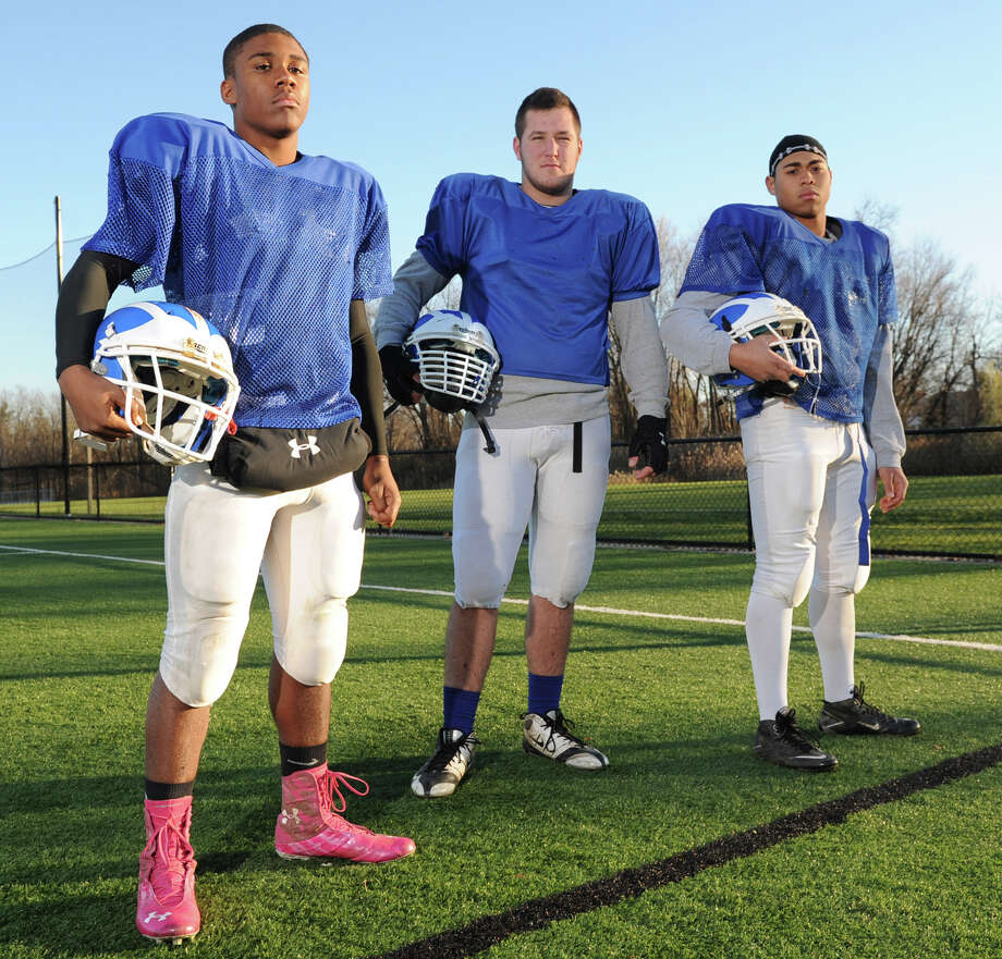 From left, Shaker football players Jackson Kenny, running back and cornerback, Schuyler Huntington, offensive guard and defensive tackle, and Jared Kirkey, linebacker pose for a photo on Wednesday, Nov. 14, 2012 in Rensselaer, N.Y.  (Lori Van Buren / Times Union) Photo: Lori Van Buren