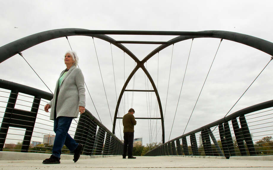 "Anne Murphy, left, checks out the new Bill Coats bridge Wednesday with her son, Floyd. Murphy approves, noting the span ""does a lot for the community by connecting both sides of Hermann Park and the bike trail."" Photo: Cody Duty, Staff / © 2012 Houston Chronicle"