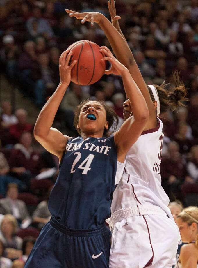Penn State's Mia Nickson drives by Texas A&M's Karla Gilbert on Wednesday in College Station. (AP Photo/Dave Einsel) Photo: Dave Einsel, Associated Press / FR43584 AP